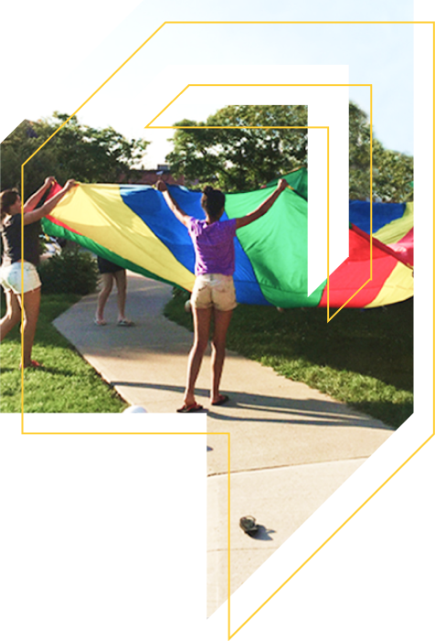 Youths playing with a parachute
