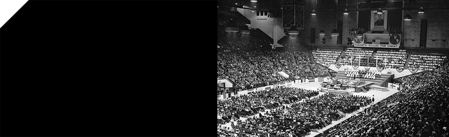 """alt=""""Black and white photo of stadium filled with young people"""""""
