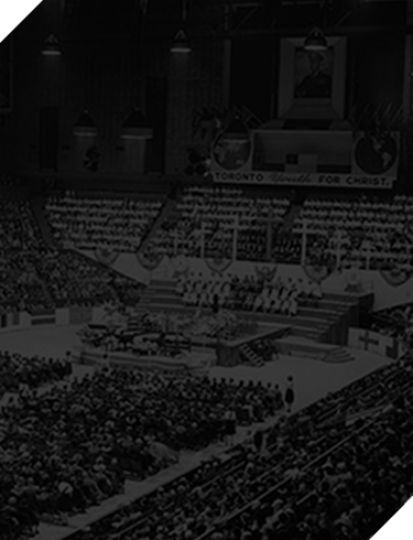 Black and white photo of stadium filled with young people