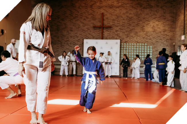 Young girl and female jiu jitsu teacher