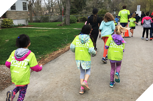 Kids running in neon green jerseys to fundraise