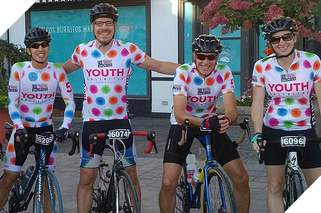 Four people participating in biking fundraiser event