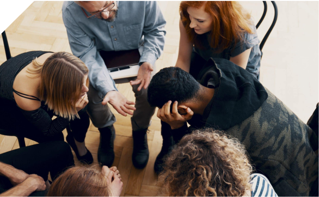 Support group sitting in a circle