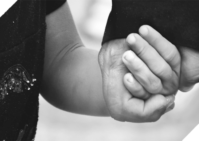 Two hands holding each other