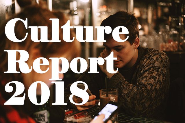 """Man and woman sitting at a restaurant with text saying """"Culture Report 2018"""""""
