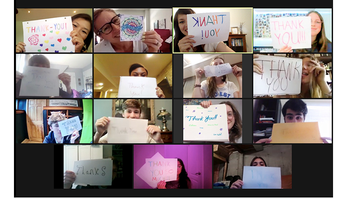 """Zoom call screenshot of LAUNCH program's online leadership course with 15 participants holding up """"thank you"""" signs"""