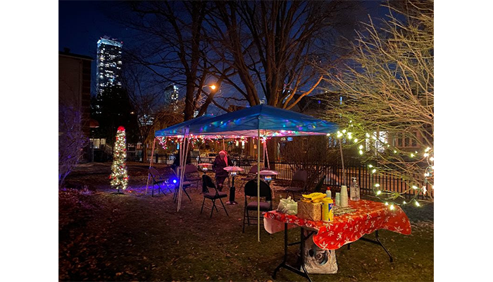 Outdoor tent, tables and lights at Light Patrol christmas party